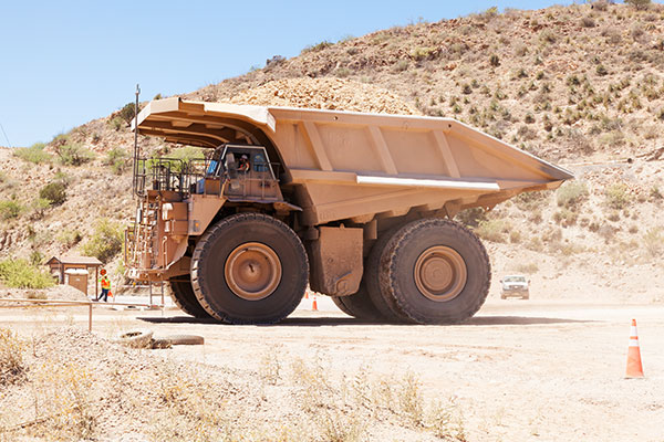 Caterpillar 793B Trucks crossing US 191, Freeport-McMoran Copper & Gold, Morenci, Arizona